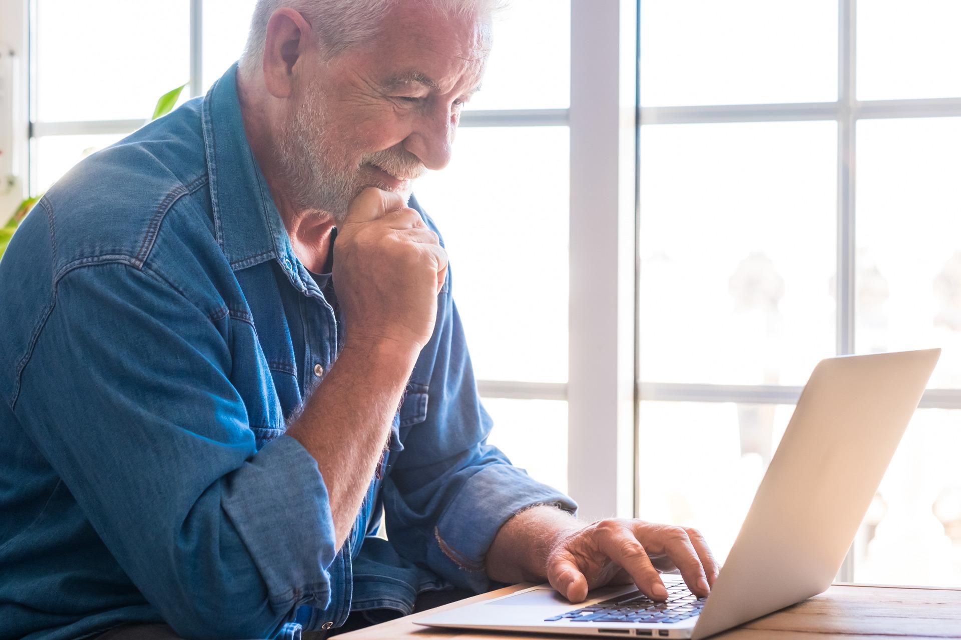 pensive-senior-man-with-a-white-beard-smiles-looki-tm4uep6.jpg